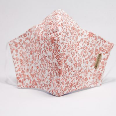 mascarilla reutilizable estampada de flores naranjas